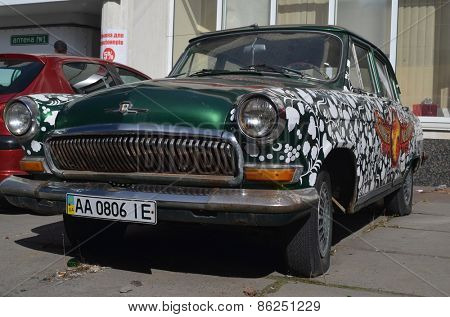 KIEV, UKRAINE - MAR 16: exterior of the vintage Soviet car GAZ-21 Volga with folk stile tuning on March 16, 2015 in Kiev,Ukraine