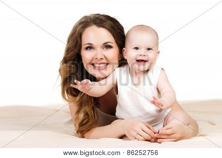 Portrait of happy mother with baby on a white background.