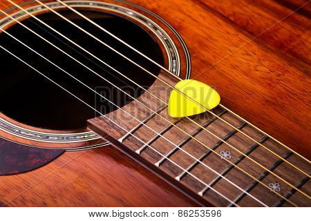 Acoustic Guitar And Pick