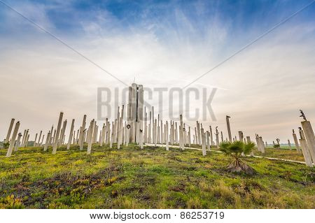 Green Field With Concrete Pillars