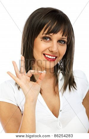 Young Woman Giving Ok Sign