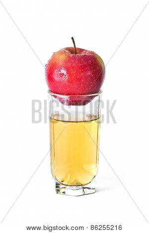 Apple Above Glass Of Juice