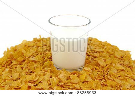 Glass of milk and corn flake cereals on a white background