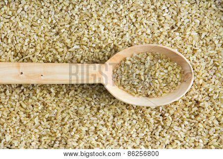 Cracked Wheat With A Wooden Spoon