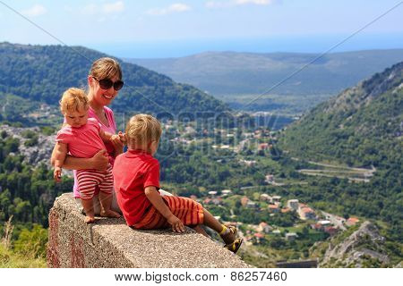 mother with kids having rest in mountains
