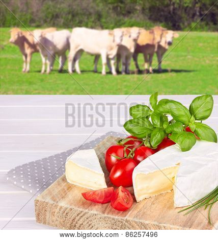 Cow Cheese, Cherry Tomato, And Basil On A Wooden Background