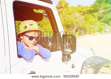 happy little boy in off road car