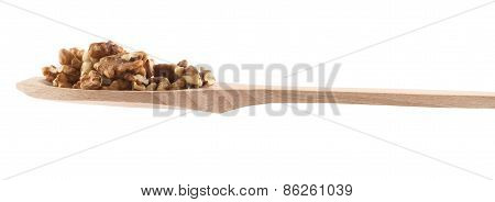 Spoon full of walnuts isolated