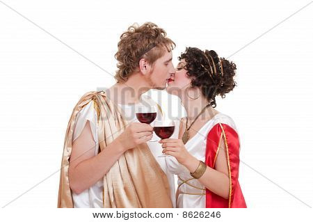 Kissing Couple With Glasses Of Wine