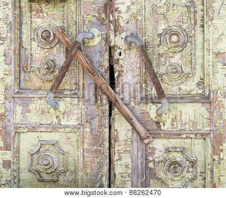 Old painted wooden boarded door