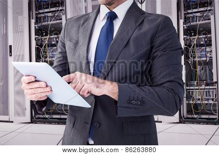 Businessman using his tablet pc against data center