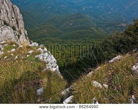 Rocks and cliffs on trekking path at Suva Planina mountain