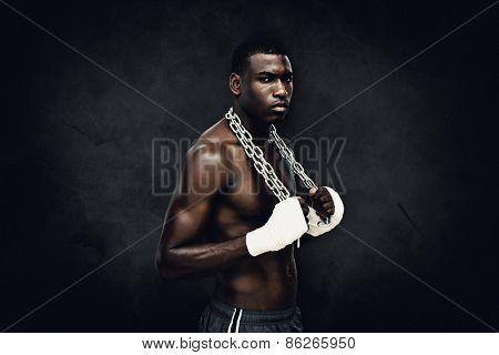 Muscular man against dark background