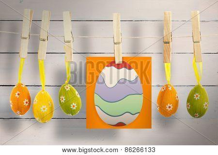 easter egg against painted blue wooden planks