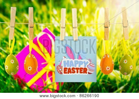 happy easter against pink gift with easter egg and yellow tulip