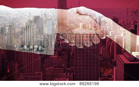 Close up of female and male hand shaking against city skyline