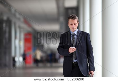 businessman thinking law on the cell phone