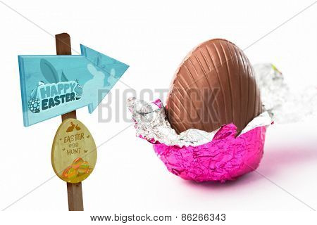 Easter egg hunt sign against easter egg unwrapped in pink foil
