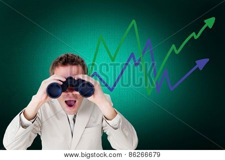 Positive businessman using binoculars against digitally generated grey background