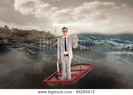 Businessman waving in boat against stormy sea with lighthouse