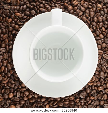 Empty cup over coffee bean background