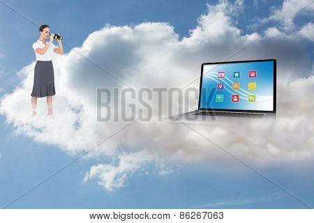 Serious elegant businesswoman looking through binoculars against cloudy sky