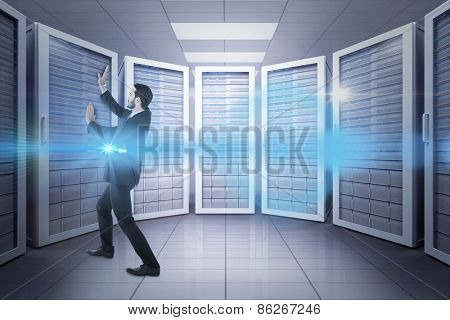 Businessman standing and pushing up against server room