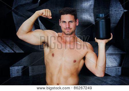 Bodybuilder with protein powder against dark room