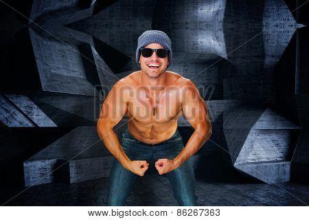 Attractive bodybuilder against dark room