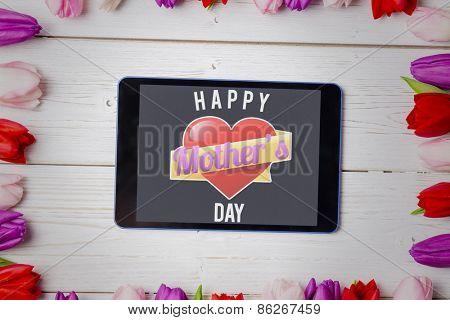 mothers heart against tulips on desk