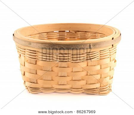 Wooden wicker basket isolated over white