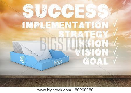 Blue inbox against success plan written on wall with sky