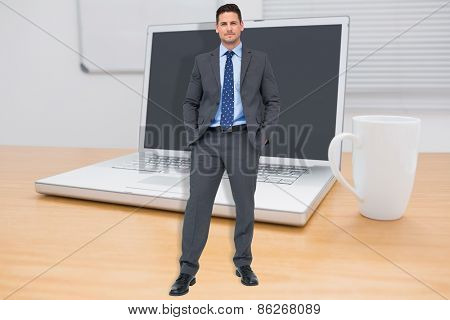 Thinking businessman against a desk with a computer