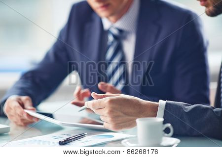 Hands of businessmen working with touchpad