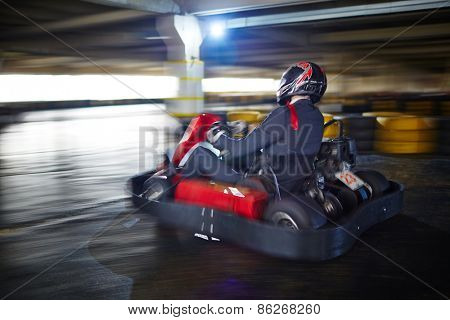 Businessman racing in go-kart