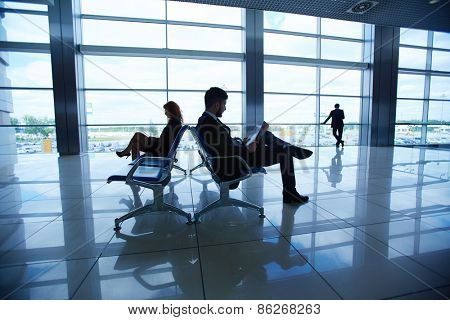 Group of businesspeople waiting for their departure in airport