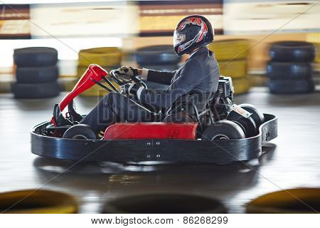 Businessman driving go-kart