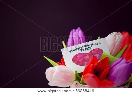 happy mothers day against tulips with note