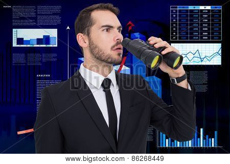 Surprised businessman standing and holding binoculars against business interface with graphs and data