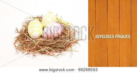 Joyeuses paques against wooden planks