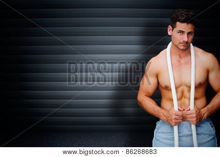 Handsome bodybuilder against black background