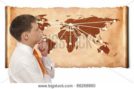 Globalization. Young business man with world map