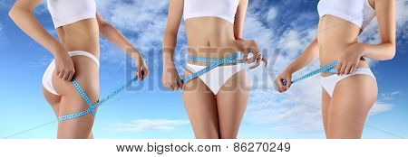 woman tape meter on buttocks and belly
