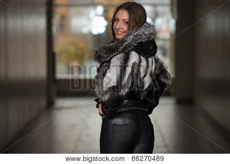 Fashion Girl Wearing Snow Jacket In Shopping Mall