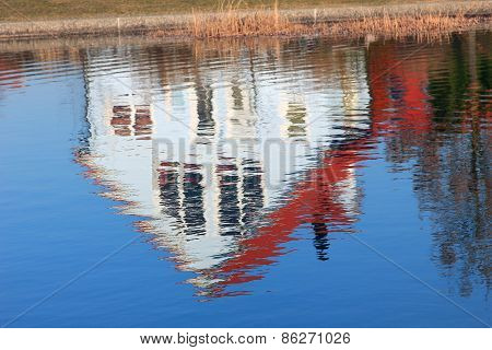 Family Home, Mirroring In A Pond