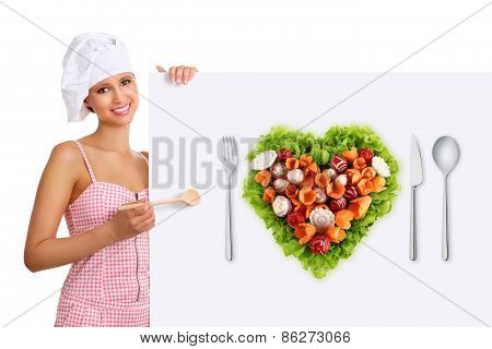 Chef Woman Pointing With A Wooden Spoon On The White Billboard