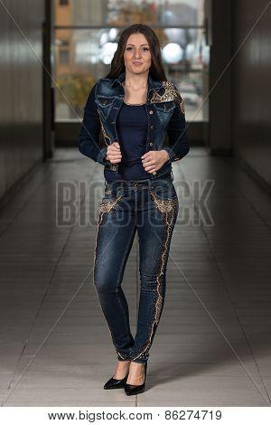 Glamour Fashion Model Wearing Blue Pants And Jacket