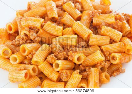 Delicious plate of macaroni served with minced meat and tomato