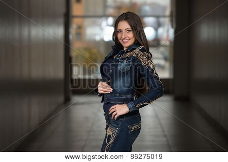 Glamour Fashion Model Wearing Blue Pants And Jacket