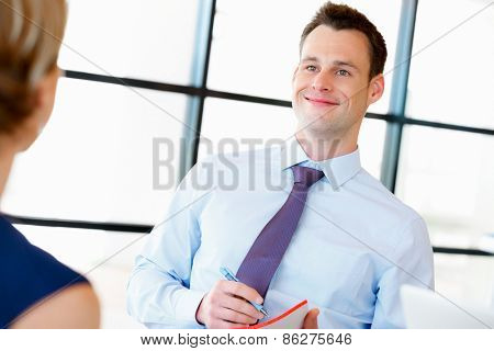Young businessman talking to his manager